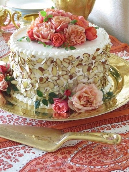 Roses, white frosting, and almonds.