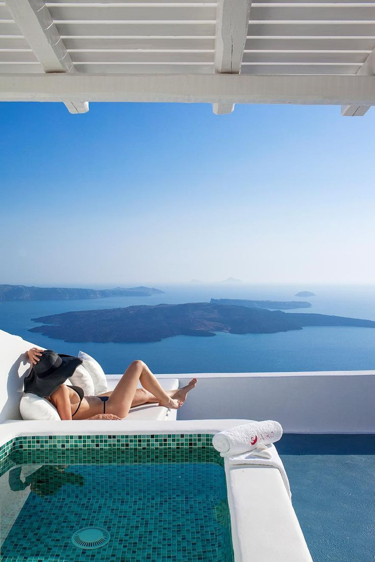 Private pools, breathtaking sea views, amazing weather. Oversized hat, optional. Greece at it's best. #Mylifemystyle