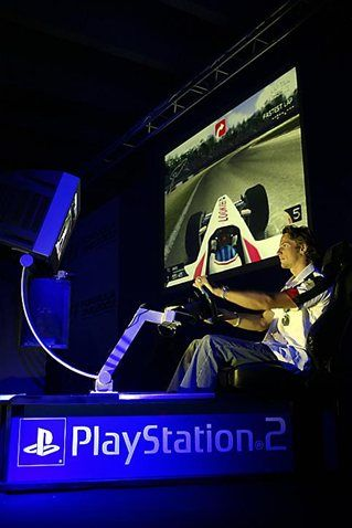 Jenson Button (GBR) BAR races the new F1 2003 game for Playstation 2. Formula One World Championship, Rd9, European Grand Prix, Preparations, Nurburgring, Germany, 26 June 2003