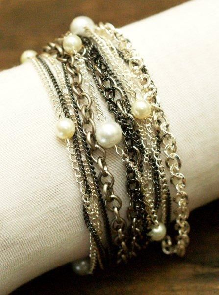 Chain and pearl multi-row bracelet.