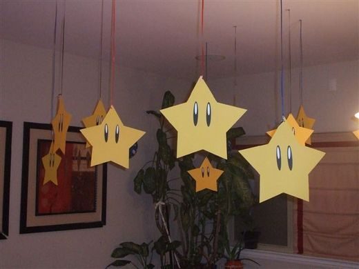 Super Mario Birthday Party DIY Decoration Ideas.  Stars hung from the ceiling.