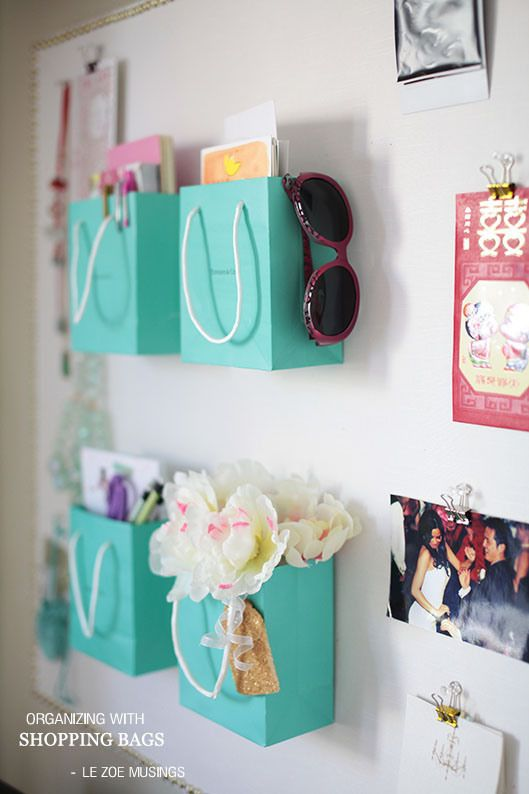 Use cute shopping bags that you collect to help organize your life! Use them as organizational compartments for pens, journals, cards, etc. finally something to do with my bags