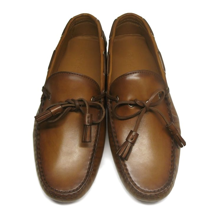 Very comfortable brown Ralph Lauren Collection Harold tassel loafers. Slip-on design. Decorative 360 lacing system for a nautical look. Tassel details at the upper. Smooth leather lining. Lightly cushioned leather insole. Textured rubber outsole. Size: 44.5 (US 11.5 / UK 10.5 / 30cm)Made in Italy.