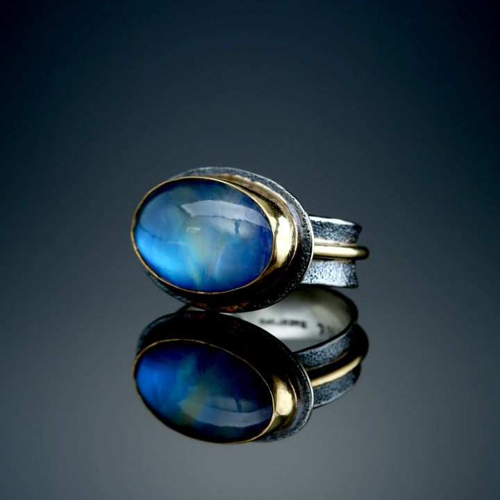 Rainbow Moonstone Ring. Fabricated Sterling Silver, 22k and 18k. www.amybuettner.com https://www.facebook.com/pages/Metalsmiths-Amy-Buettner-Tucker-Glasow/101876779907812?ref=hl https://www.etsy.com/people/amybuettner http://instagram.com/amybuettnertuckerglasow