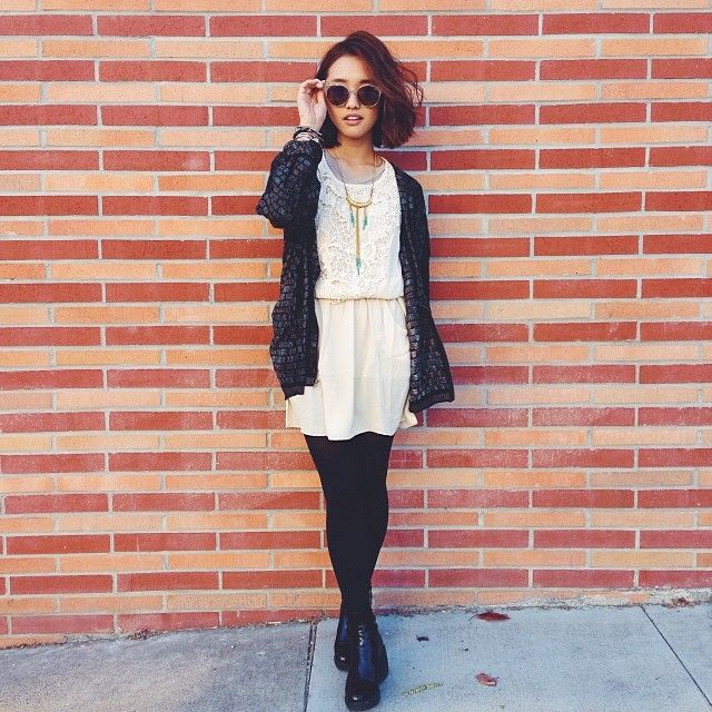 Jenn Im:   dark slouch cardigan + white dress + black tights + black booties