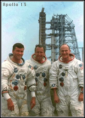 Apollo 13 crew portrait with their Saturn V behind, including original CMP member Ken Mattingly, who was pulled from the flight 48 hours before launch and replaced with backup Jack Swigert, due to the possibility of being exposed to the measles.