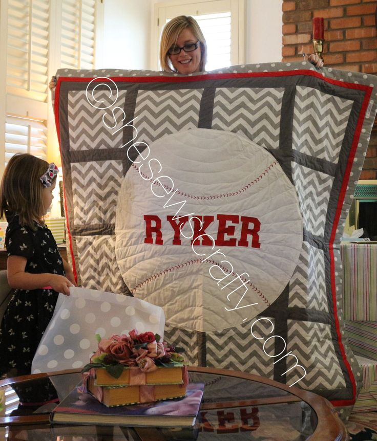 Custom made chevron, polka dots, baseball quilt, with grey and red accents. Love it!