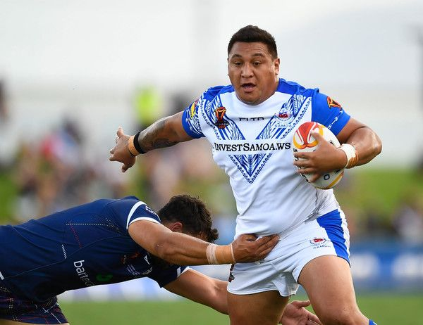 Canberra Raiders Josh Papalii of Samoa is tackled during the 2017 Rugby League World Cup match between Samoa and Scotland at Barlow Park on November 11, 2017 in Cairns, Australia.