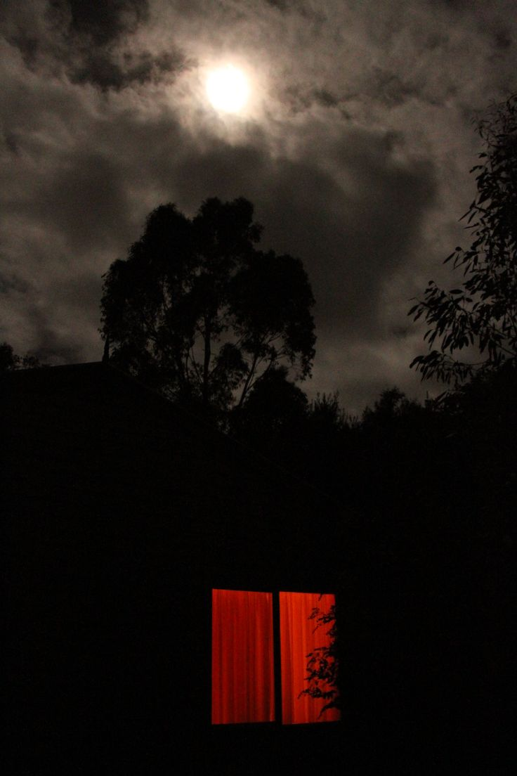 (Behind the Red Window!!!) Driving along a dirt road in Gippsland came across this house out of the way, loved the red window and the moon peeking through the night clouds. I wanted to creep across the front yard and see what was going on but my wife threatened to drive off if I did.