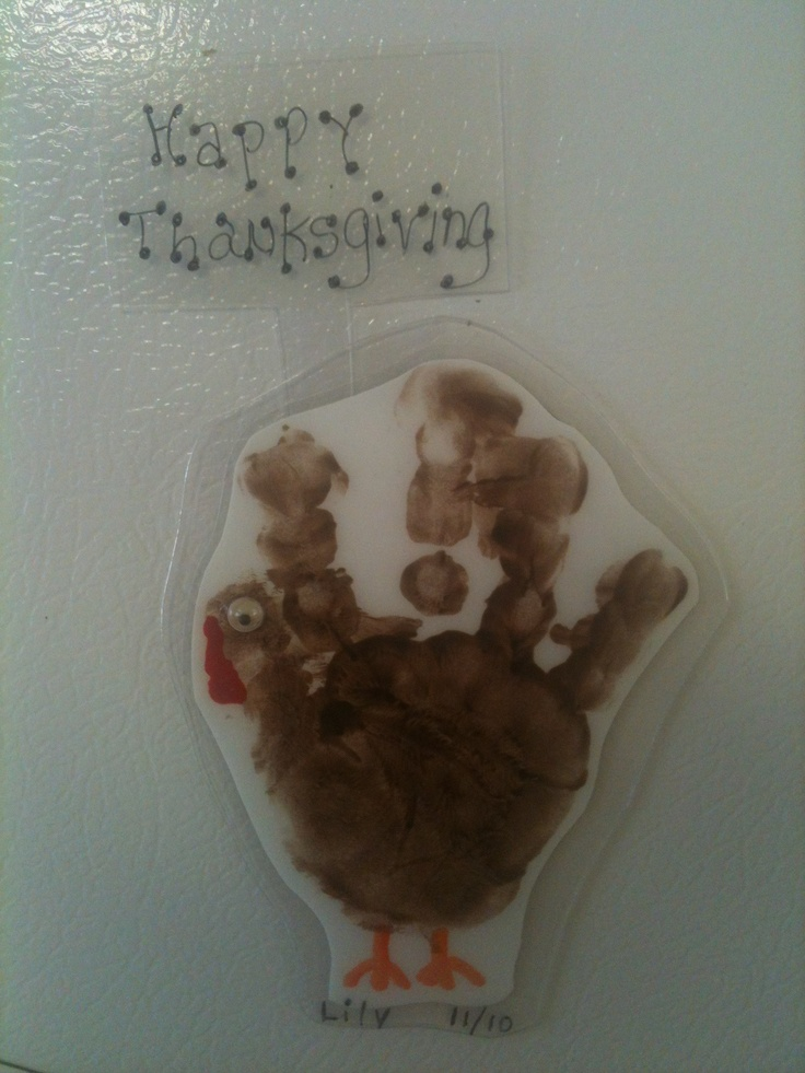 Laminated Turkey handprint keepsake Magnet!  The turkey appears to be holding a Happy Thanksgiving sign! Every parent will love this little gobbler for years to come!
