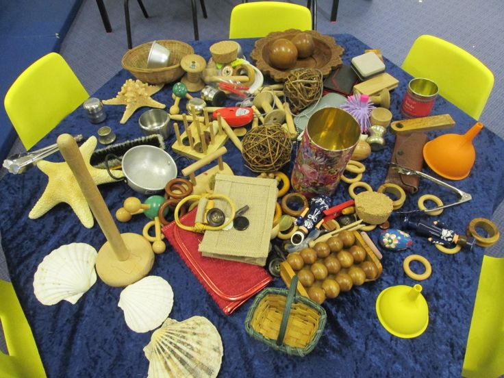 Aneta's Heuristic Play table.  Lots of interesting objects for the children to explore in any way they choose!