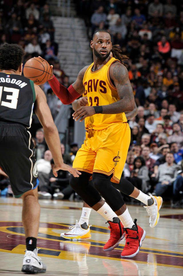 LeBron James #23 of the Cleveland Cavaliers looks to pass the ball during a game against the Milwaukee Bucks on February 27, 2017 at Quicken Loans Arena in Cleveland, Ohio.