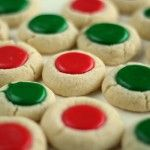 Will fill with white icing topped with Christmas colored sugar -- less artificial color.    Christmas Thumb print Cookies from The Bearfoot Baker