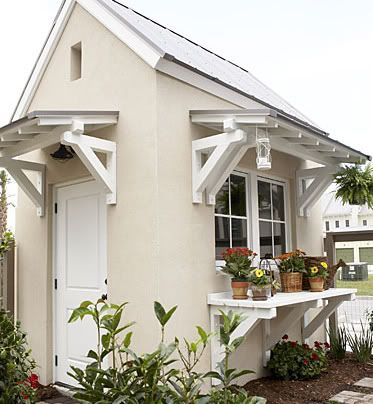 White Garden Shed with Shelf and nice roof idea for the overhang I want. I want at least 6 feet. This would compliment the house too--in grey and white, a tin metal roof would give an old fashion touch.