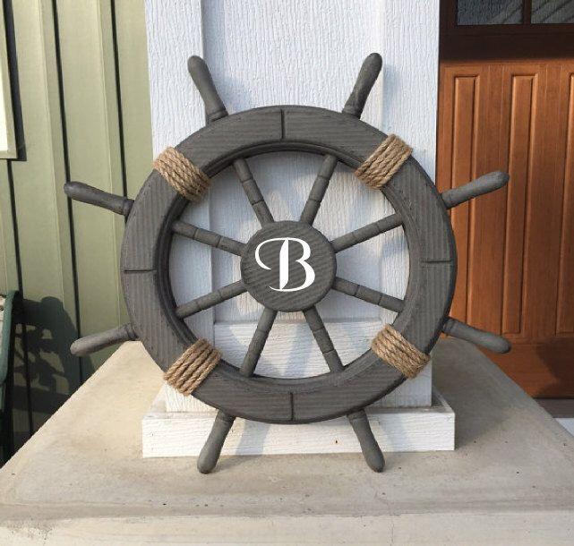 "Monogrammed Antique Grey 18"" Nautical Ship Wheel, Personalized ship's wheel, Custom Nautical decor, Personalized wedding gift - 087 by ParadiseDecor on Etsy https://www.etsy.com/listing/250271315/monogrammed-antique-grey-18-nautical"