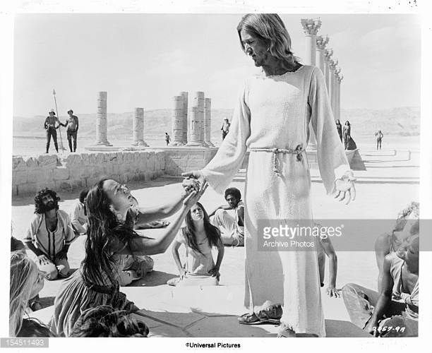 Yvonne Elliman is among the followers who kneel at the feet of Ted Neeley in a scene from the film 'Jesus Christ Superstar' 1973