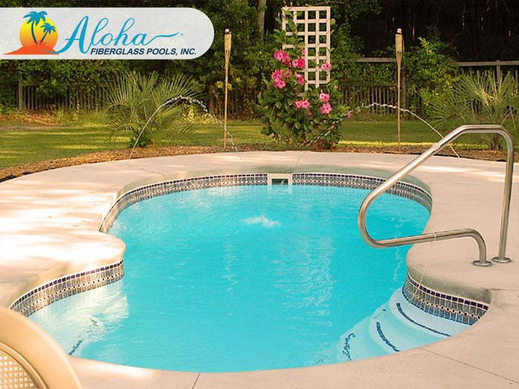 """The Neptune features elegant side entry steps with a beautifully curved seat that wraps around the end of the pool. This unique shape is both elegant and modern, and provides many design opportunities. The Neptune is a free form fiberglass pool that is 11'x23' and goes to 5'6"""" in depth.  For more information about Aloha Fiberglass Pools or to find a local pool builder in your area that can assist you, visit www.AlohaFiberglassPools.com or call (800) 786-2318."""