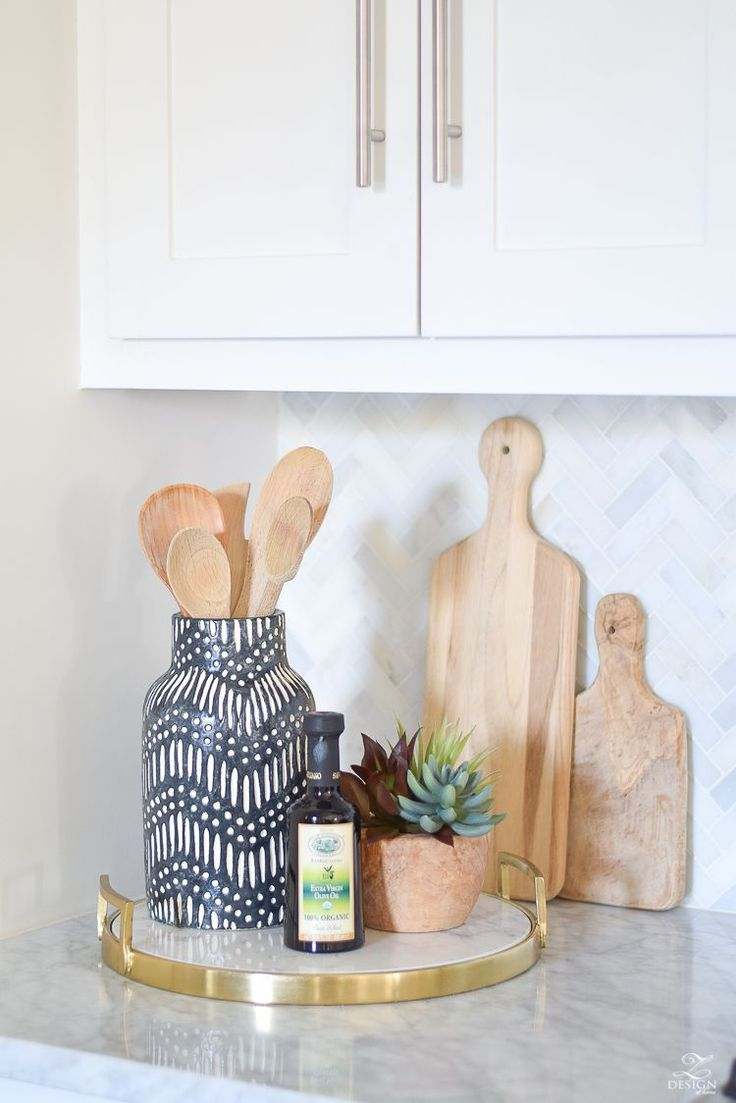 marble and brass tray black and white global inspired vase faux succulents in pot cutting boards white farmhouse kitchen marble herringbone tile backsplash tips for styling the kitchen counters counter top decor
