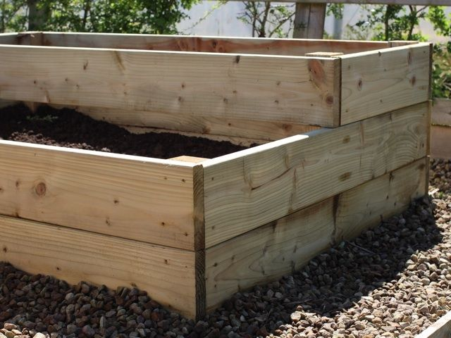 thick timber boards used in its construction have no problem holding in all that soil. 2 Tiers for a stepped effect in the vegetable garden. #RaisedVegetableBeds