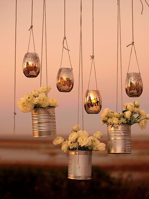 """Creative Lighting and Décor :Intersperse hanging votives with flower """"baskets"""" made of metal cans. Drill holes for string, fill them with blooms, and decorate a trellis, gazebo, or window. Hanging silver votives, $16 for six, Jamali Floral & Garden Supplies."""