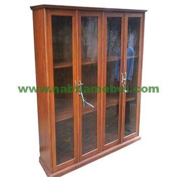 Lemari Buku Minimalis Surabaya produk furniture dengan bahan baku kayu jati yang diproduksi pengrajin mebel jepara berpengalaman.