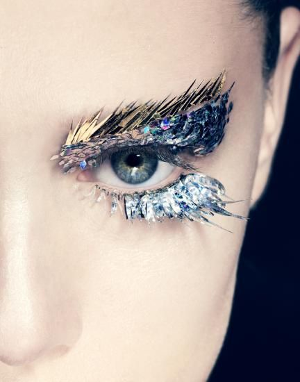 Try an extravagant eye makeup. #PANDORAloves how makeup artist Romero Jennings has used metallic strips to create a feathery effect.