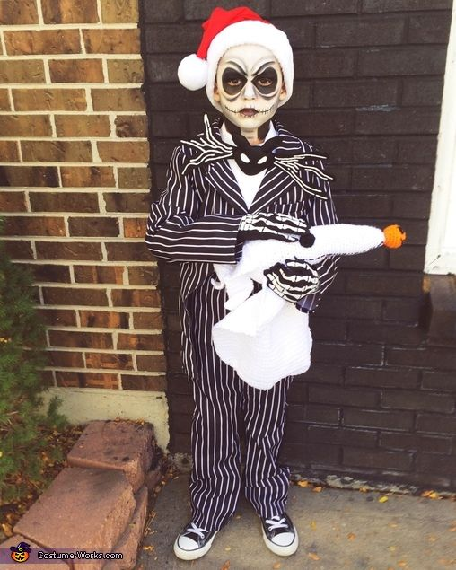 Brooke: My 7 year old son in his Jack Skellington costume for the kids contest. He's wearing a thrift costume suit that I altered and sewed to resemble a tuxedo with...