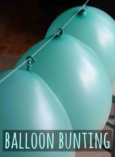 Balloon bunting. Blow up balloons and tie a knot. Use a needle and dental floss to string balloons together. Hang 'em up! No more need for helium. by mollie