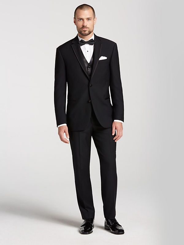 In her first collection of designer tuxedos, Vera Wang BLACK tuxedos are modern, fitted for the stylish groom. Visit Men's Wearhouse for Vera Wang tuxes.