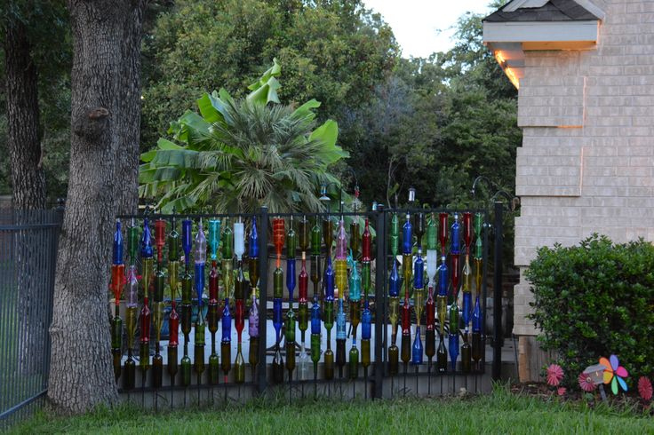 Lisa & Jonathan's very own wine bottle fence - FINALLY, it's all up. :)