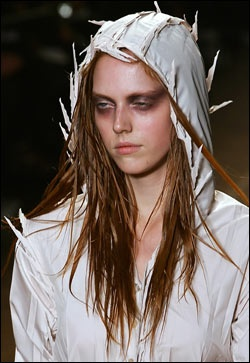 Naoki Takizawa for Issey Miyake  Edgy detail, like the spikes in this hooded dress, pair well with the dramatic makeup worn by the models.  (Text by Norman Dalager/Boston.com staff, Getty Images photo)