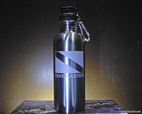 This etched brushed stainless steel bottle is for you, or for the scuba divemaster in your life that has everything.  You are looking at ONE etched stainless steel bottle. It has a Scuba Dive Flag and