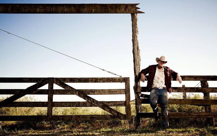 When Watt's playing days are done, he envisions a life with a wife and kids and a house on a nice bit of land in Wisconsin.  Prop Styling by Anthony A. Altomare Wardrobe Styling by Michael Nash  Grooming by Juanita Lyon WARDROBE: Henley and Denim: Ralph Lauren Denim & Supply; Boots: Cavenders; Belt: Black Jack available at Cavender's; Jacket: Stylists Own; Hat and Belt Buckle: Watt's Own