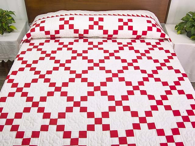 Amish quilts. I didn't know how much I love red and white quilts. most are amazing...this is just beautiful...