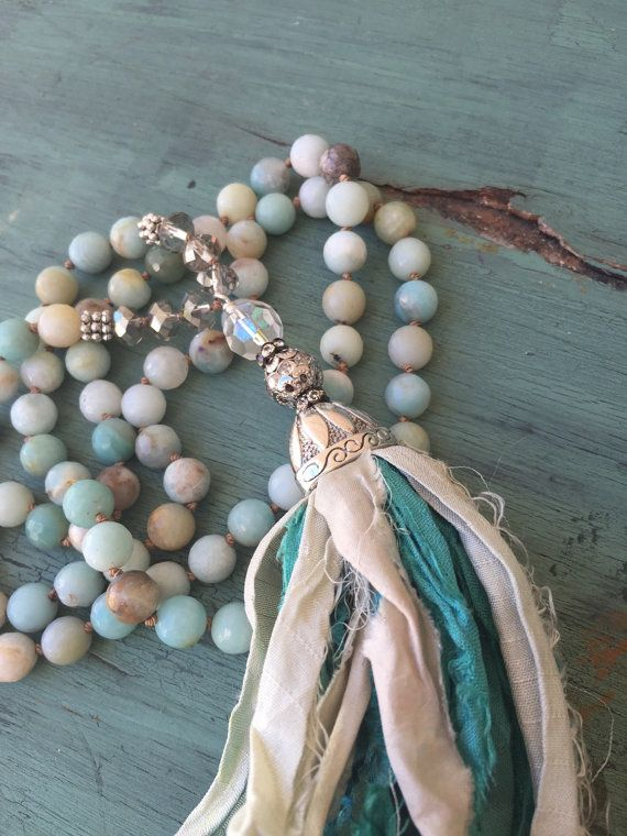 Im in love with these tassels....I think they will be great for most any outfit, but can really picture it with a bathing suit, sarong or beachy cover up. I have hand knotted these 8mm faceted amazonite beads using brown silk. The tassel is made by me, and Ive mixed two colors of sari