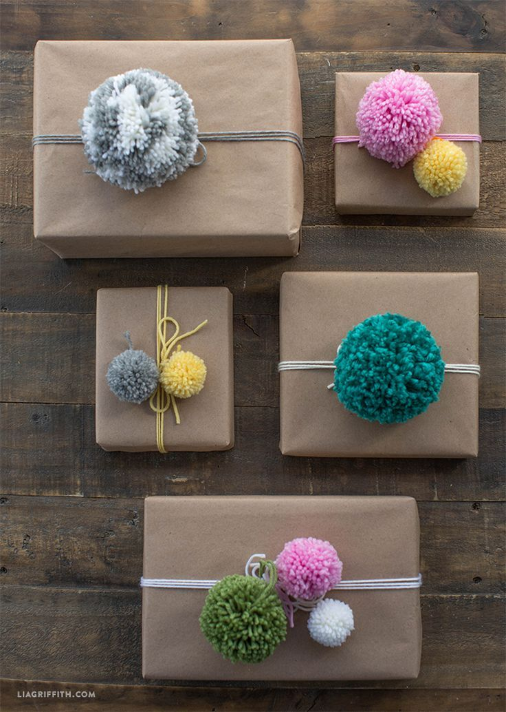 Adorable gift wrap using pom poms! Wonderful and easy handmade Christmas decorations and perfect craft for children. | http://www.LiaGriffith.com