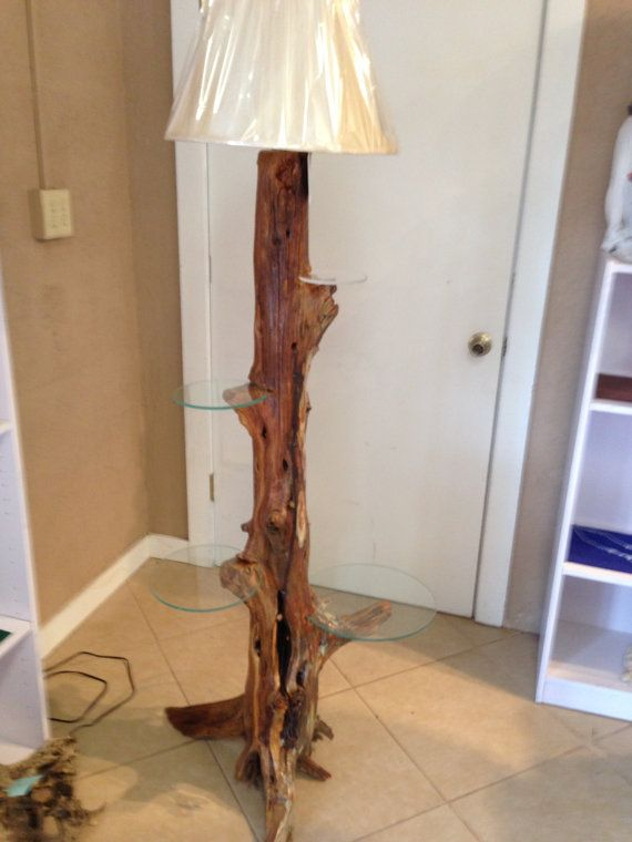 cedar stump lamp with 4 glass shelves placed by