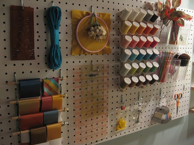 Easily organize your #craft and #sewing supplies on a peg board! Paint it the same color as your wall for easy blending, or paint it a fun pop of color to make it stand out and add some organizational decor to your space.