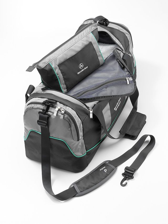 Practical, roomy and well designed: this sports bag features a large main compartment,a separate washbag, a front pocket and two zipped side pockets. There is also a compartment for wet clothes inside. Petronas green piping contrasts attractively with the subtle anthracite and silver-coloured design. Separate washbag Detachable, adjustable shoulder strap Embroidered logo Size approx. 35 x 30 x 72 cm Capacity approx. 60 l By Deuter for Mercedes-Benz