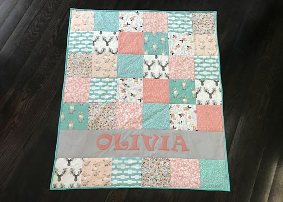 Girly Coral and Aqua Woodland Baby Quilt - Personalized Baby Quilt - Blanket - Crib Size - Deer - Arrow - Rustic - Modern - Antler - boho bohemian girl CHOOSE YOUR NAME!!! Dimensions Baby Size: 36 inches wide by 42 inches tall Toddler Size: 48 inches wide by 60 inches tall Materials: Front: Quilting Cottons Back: Minky Dimple Dot Whether youre searching for a baby quilt to adorn your babys nursery or a gift for a modern, stylish Mom to be, this personalized baby quilt is just right. W...