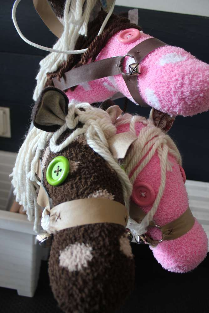 Awesome! Love the idea to use fuzzy socks for the stick horses!!! Cowgirl Birthday Party Ideas