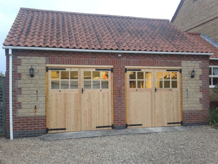 Could work if the single doors were extra wide. Classic Double Carriage Garage Doors With Oak Summit Collection ...