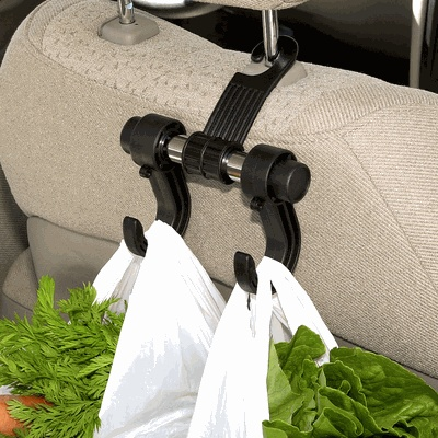 They're sturdy & keep groceries from flying out of their bags. They're also very good to hang your purse on, to keep it from riding top-down on the floor of the car. :-)  $3.99, organize.comCar Seats, Ideas, Cars Organic, Grocery Bags, Cars Hangers, Travel Accessories, Products, Cars Seats, Hangers Hooks