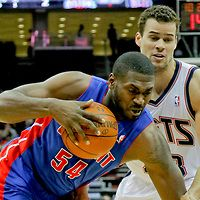 Feb 1, 2012; Newark, NJ, USA;  Detroit Pistons forward/center Jason Maxiell (54) drives to the basket against New Jersey Nets power forward Kris Humphries (43) at the Prudential Center. Mandatory Credit: Jim O'Connor-
