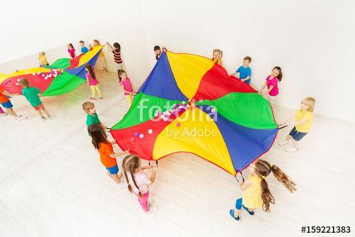 """Laden Sie das lizenzfreie Foto """"Kids playing parachute games in light gym"""" von Sergey Novikov zum günstigen Preis auf Fotolia.com herunter. Stöbern Sie in unserer Bilddatenbank und finden Sie schnell das perfekte Stockfoto für Ihr Marketing-Projekt!"""