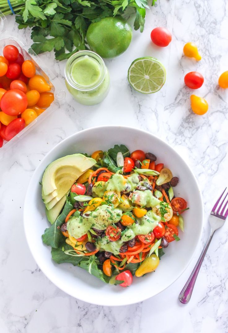 Southwestern Sweet Potato Noodle Bowl - A vibrant mixture of nutrient-packed veggies, fibre and protein-rich black beans, juicy sweet tomatoes, and a super creamy cilantro avocado dressing. Vegan and gluten-free with a paleo option provided. Recipe via Eat Spin Run Repeat