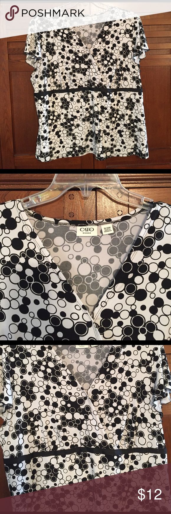 Black and white polka dot blouse Cato blouse. 18/20w black and white polka dot blouse. Short sleeves with a black ribbon band under wrap. Cato Tops Blouses