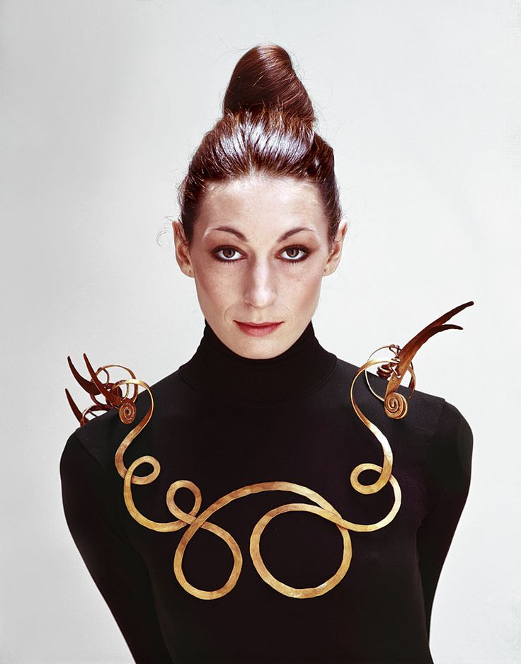 """""""The Jealous Husband""""—a 1940 necklace made of brass wire in which a spectacular swirling piece has five protruding """"teeth-like"""" elements that are there to keep potential suitors at bay. His work is gorgeous, but he also had a great sense of humor. Worn by a young Angelica Huston."""