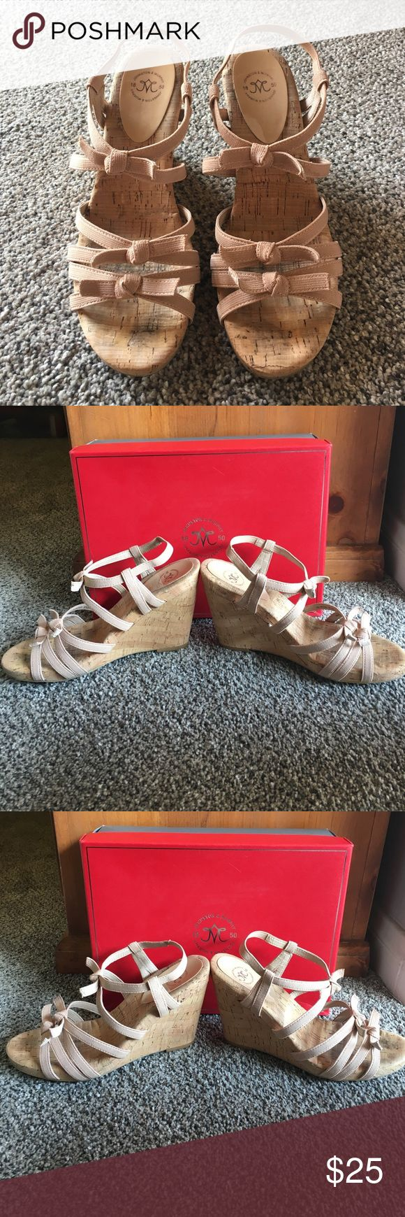 """Johnston & Murphy Strappy Sandals Adorable, gently worn nude strappy sandals by Johnston and Murphy.  Worn a handful of times.  4 1/8"""" cork wedge heel.  Straps are elastic outside, lined with leather.  Adorable knotted bow-like details! Reasonable offers welcome, please use the """"Offer"""" button  Johnston & Murphy Shoes Sandals"""