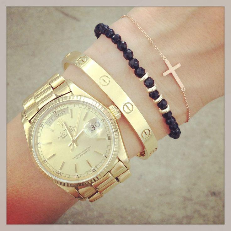 Rolex watch, Cartier Love bracelet, Anine Bing bracelet